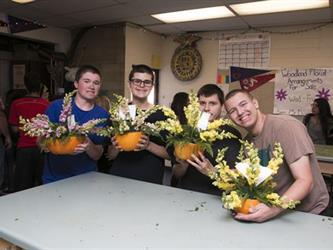 4 boys showing bouquets